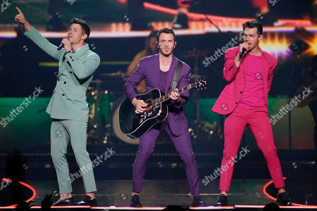 """Stock Picture of Nick Jonas, Kevin Jonas, Joe Jonas. Nick Jonas, from left, Kevin Jonas, and Joe Jonas, of the Jonas Brothers, perform during their """"Happiness Begins Tour"""" at the United Center, in Chicago"""