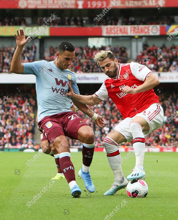 Stock Picture of Sead KolaA¡inac of Arsenal battles with Alan Hutton of Aston Villa