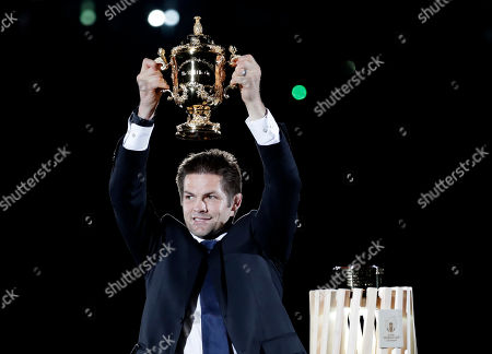 Former All Blacks captain Richie McCaw holds the Web Ellis Cup aloft during the opening ceremony of the Rugby World Cup ahead of the Pool A game at Tokyo Stadium between Russia and Japan in Tokyo, Japan