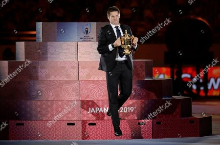 Former All Blacks captain Richie McCaw carries the Web Ellis Cup during the opening ceremony of the Rugby World Cup ahead of the Pool A game at Tokyo Stadium between Russia and Japan in Tokyo, Japan