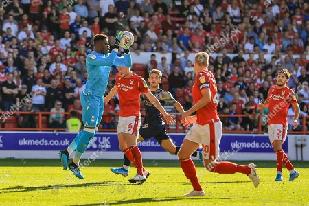 Stock Image of 21st September 2019, City Ground, Nottingham, England; Sky Bet Championship Football, Nottingham Forest vs Barnsley ; Brice Samba (30) of Nottingham Forest catches the cross from Luke Thomas (16) of Barnsley with ease 