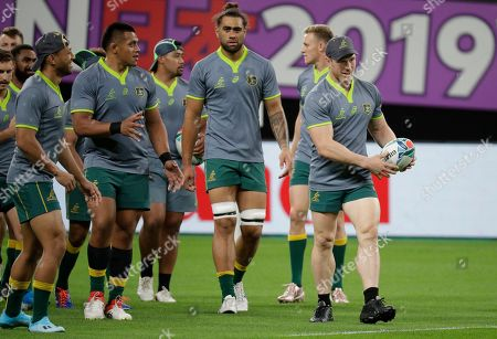 Australia's rugby team player David Pocock holds the ball during their training at the Sapporo Dome before the start of the Rugby World Cup in Sapporo, Northern Japan, . Australia will play against Fiji on Saturday Sept. 21 in their first game
