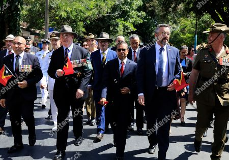 East Timor Prime Minister Taur Matan Ruak (C) and Australian Former Commander of the International Peacekeeping Mission for East Timor (INTERFET) Peter Cosgrove (2L) walks during 20th anniversary of the deployment of INTERFET in Dili, East Timor, also known as Timor Leste, 20 September 2019. The commemorations marked the deployment of the multi national force to stabilise East Timor and to control its borders after violence erupted following the announcement of referendum on independence from Indonesia.