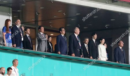 Japan's Prime Minister Shinzo Abe, center, and Prince Akishino, third from right and Princess Kiko, second from right, wait for the start of the Rugby World Cup Pool A game at Tokyo Stadium between Russia and Japan in Tokyo, Japan
