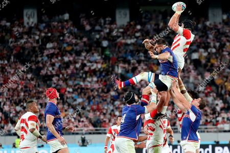 Japan's James Moore, top right, wins a ball in a lineout during the Rugby World Cup Pool A game at Tokyo Stadium between Russia and Japan in Tokyo, Japan