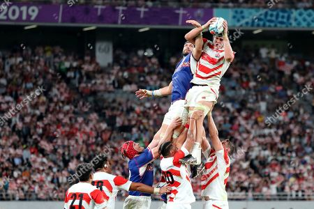 Japan's James Moore, right, and Russia's Andrey Ostrikov, left, vie for a ball in a lineout during the Rugby World Cup Pool A game at Tokyo Stadium between Russia and Japan in Tokyo, Japan