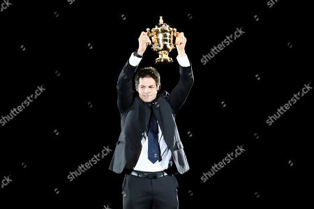 Former All Blacks captain Richie McCaw brings the Web Ellis Cup onto the field during the opening ceremony for the Rugby World Cup at Tokyo Stadium in Tokyo, Japan