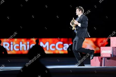 Former All Blacks captain Richie McCaw holds the Web Ellis Cup during the opening ceremony for the Rugby World Cup at the Rugby World Cup Pool A game at Tokyo Stadium between Russia and Japan in Tokyo, Japan