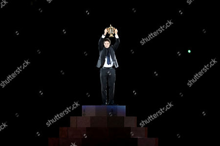 Former All Blacks captain Richie McCaw holds the Webb Ellis Cup aloft during the opening ceremony for the Rugby World Cup at the Rugby World Cup Pool A game at Tokyo Stadium between Russia and Japan in Tokyo, Japan