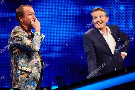Mark King and host Bradley Walsh facing The Chaser