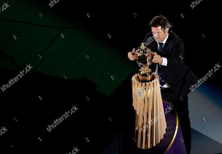 Former All Blacks captain Richie McCaw places the Web Ellis Cup on a plinth during the opening ceremony for the Rugby World Cup at the Rugby World Cup Pool A game at Tokyo Stadium between Russia and Japan in Tokyo, Japan