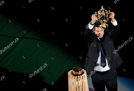Former All Blacks captain Richie McCaw holds the Web Ellis Cup aloft during the opening ceremony for the Rugby World Cup at the Rugby World Cup Pool A game at Tokyo Stadium between Russia and Japan in Tokyo, Japan