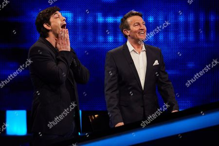 Adam Garcia and host Bradley Walsh facing The Chaser