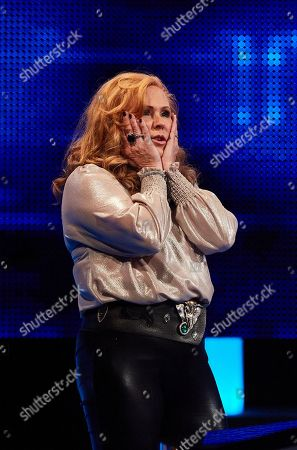 Stock Picture of Carol Decker facing The Chaser