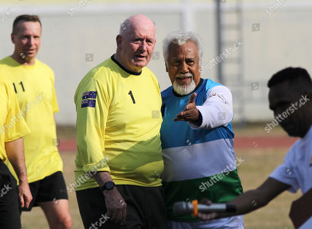 Xanana Gusmao, Peter Coscrove. East Timorese independence hero and former president Xanana Gusmao, right, leads former Australian Governor-General and International Forces in East Timor (INTERFET) Commander Peter Cosgrove, center left, before the start of a soccer match between a veteran Australia team and their Timorese counterparts held to commemorate the 20th anniversary of INTERFET deployment, in Dili, East Timor