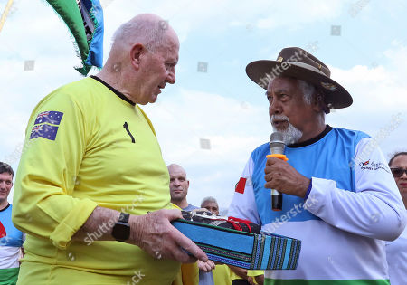 Xanana Gusmao, Peter Cosgrove. East Timorese independence hero and former President Xanana Gusmao, right, exchange souvenirs with former Australian Governor-General and International Forces in East Timor (INTERFET) Commander Peter Cosgrove, left, prior to the start of a soccer match between an Australian veteran team and their Timorese counterpart held to commemorate the 20th anniversary of INTERFET deployment, in Dili, East Timor