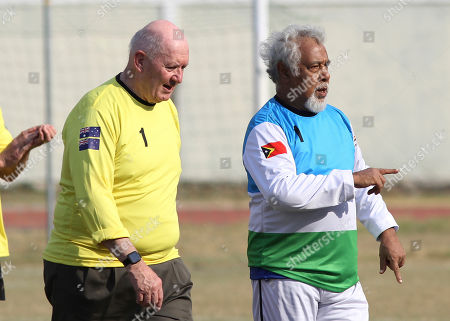Stock Photo of Xanana Gusmao, Peter Cosgrove. East Timorese independence hero and former President Xanana Gusmao, right, walks with former Australian Governor-General and International Forces in East Timor (INTERFET) Commander Peter Cosgrove as they attend a soccer match between a veteran Australian team and their Timorese counterparts held to commemorate the 20th anniversary of INTERFET deployment, in Dili, East Timor