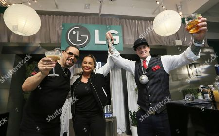 """Stock Picture of Vanilla Ice, right, is crowned the winner after going head-to-head against Ice-T, left, in the """"The Ultimate Ice Off,"""" an epic cocktail making competition during which the two used LG's exclusive round Craft Ice? to mix the perfect drink, on at the Craft Ice House by LG in New York"""
