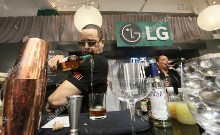 Stock Photo of The two most iconic ices of all time, Ice-T, pictured, and Vanilla Ice, battle in an epic cocktail making competition using Craft Ice? from LG's new InstaView refrigerators, the first-ever refrigerator to make craft ice, on at The Craft Ice House by LG in New York