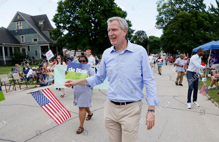 Democratic presidential candidate New York Mayor Bill DeBlasio walks in the Independence Fourth of July parade in Independence, Iowa. DeBlasio said Friday, Sept. 20 that he is ending his campaign for the Democratic presidential nomination