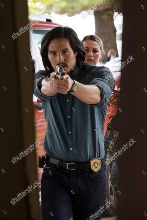 Stock Photo of Desmond Chiam as Wyatt Cole and Laura Gordon as Sgt. Kristy Ellis