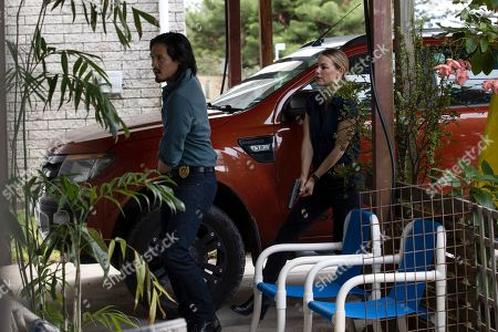 Stock Picture of Desmond Chiam as Wyatt Cole and Laura Gordon as Sgt. Kristy Ellis