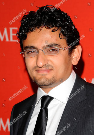 """Egyptian Internet Activist Wael Ghonim attends the Time 100 Gala, celebrating the 100 most influential people in the world in New York. Ghonim said late in a video on his twitter account that authorities raided his parents' house in Cairo and arrested his brother Hazem, whom he described as """"a political person"""" and confiscated his parents' passports. Ghonim alleges that the Egyptian embassy in the U.S. threatened him the previous day """"something will happen"""" if he didn't stop criticizing Egypt's government on social media"""