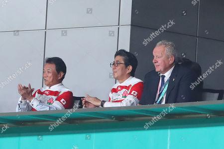 (L-R) Taro Aso, Shinzo Abe during the Pool A match
