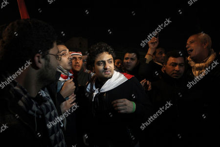 """Egyptian Wael Ghonim, center, walks into Tahrir Square after Egyptian President Hosni Mubarak's televised statement to his nation, in downtown Cairo, Egypt. Ghonim said late in a video on his twitter account that authorities raided his parents' house in Cairo and arrested his brother Hazem, whom he described as """"a political person"""" and confiscated his parents' passports. Ghonim alleges that the Egyptian embassy in the U.S. threatened him the previous day """"something will happen"""" if he didn't stop criticizing Egypt's government on social media"""