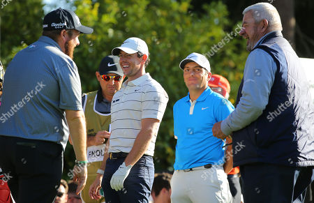 Rory McIlroy (C) of Northern Ireland talks with Shane Lowry (L) of Ireland and Francesco Molinari of Italy during the tournment