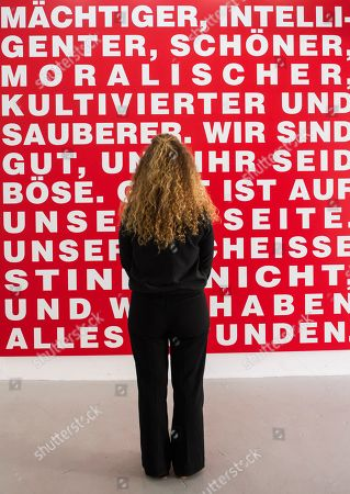 A woman stands in front of the work 'Untitled (Meine Leute sind besser als ihre Leute, 1994/2016)' by Barbara Kruger during the press preview for the exhibition 'Barbara Kruger' in Goslar, Germany, . The 73-year-old American conceptual artist Barbara Kruger receives the Goslar Kaiserring Award 2019 in Goslar on Saturday, Sept. 21, 2019. The undoped Kaiserring is considered one of the most important international awards for modern art. The exhibition starts on Sept. 21, 2019 and lasts until Jan. 26, 2020