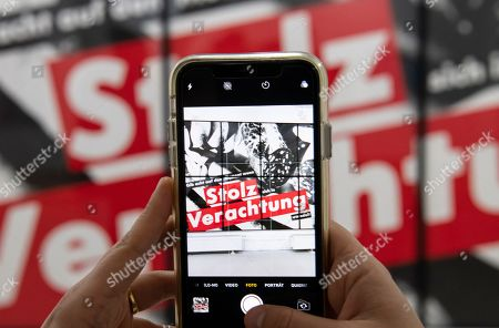 A woman takes a picture of the work 'Gib Acht auf den Moment wenn Stolz sich in Verachtung wandelt' (1990) by Barbara Kruger during the press preview for the exhibition 'Barbara Kruger' in Goslar, Germany, . The 73-year-old American conceptual artist Barbara Kruger receives the Goslar Kaiserring Award 2019 in Goslar on Saturday, Sept. 21, 2019. The undoped Kaiserring is considered one of the most important international awards for modern art. The exhibition starts on Sept. 21, 2019 and lasts until Jan. 26, 2020