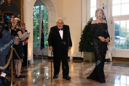 Stock Photo of Henry Kissinger, Nancy Kissinger. Former Secretary of State Henry Kissinger, left, and wife Nancy Kissinger arrive for a State Dinner with Australian Prime Minister Scott Morrison and President Donald Trump at the White House, in Washington