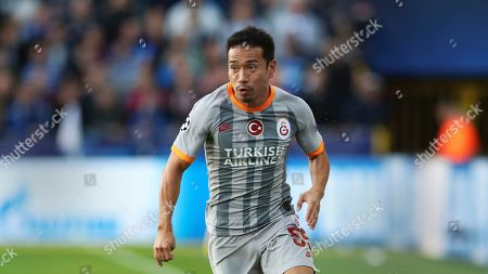 Galatasaray's Yuto Nagatomo runs with the ball during the Champions League group A soccer match between Club Brugge and Galatasaray at the Jan Breydel stadium in Bruges, Belgium