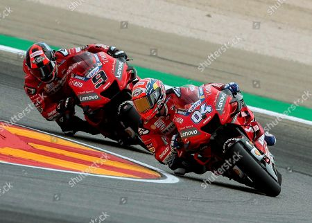 Italian MotoGP riders of the Ducati Team Andrea Dovizioso (R) and Danilo Petrucci (L) take a bend during the first training session of the Motorcycling Grand Prix of Aragon at the MotorLand Aragon circuit in Alcaniz, northeastern Spain, 20 September 2019.
