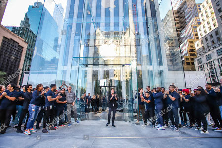 Apple CEO Tim Cook greets customers at the grand reopening of Apple's flagship Apple Fifth Avenue retail store.