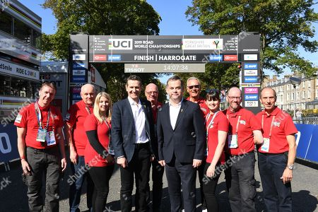 Start finish gantry at Harrogate. Sports Minister Nigel Adams and Y2019 CEO Andy Hindley with volunteers in Harrogate today