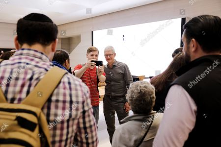 Stock Image of Apple CEO Tim Cook (C-R) takes pictures with customers in the newly refurbished Apple store on Fifth Avenue in New York, New York, USA, 20 September 2019. The store reopens in time for the company to sell new products including the iPhone 11 and Series 5 Apple Watches.