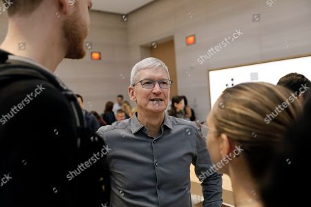 Apple CEO Tim Cook (C) speaks with customers in the newly refurbished Apple store on Fifth Avenue in New York, New York, USA, 20 September 2019. The store reopens in time for the company to sell new products including the iPhone 11 and Series 5 Apple Watches.