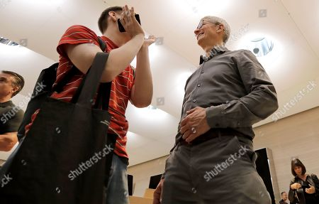 Apple CEO Tim Cook (R) speaks with customers in the newly refurbished Apple store on Fifth Avenue in New York, New York, USA, 20 September 2019. The store reopens in time for the company to sell new products including the iPhone 11 and Series 5 Apple Watches.