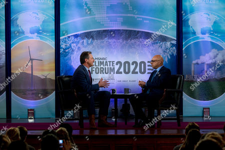 Democratic presidential candidate Montana Gov. Steve Bullock, accompanied by Ali Velshi, speaks during the Climate Forum at Georgetown University, in Washington