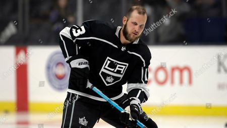 Los Angeles Kings' Dustin Brown warms up during a preseason NHL hockey game against the Arizona Coyotes, in Los Angeles