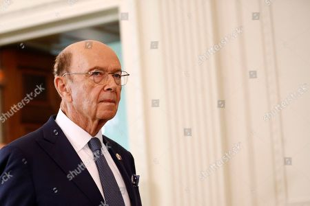 Commerce Secretary Wilbur Ross walks into the East Room of the White House before a news conference with President Trump and Australian Prime Minister Scott Morrison, in Washington