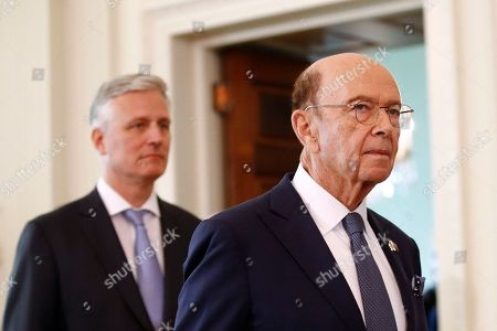 Commerce Secretary Wilbur Ross, right, walks with National security adviser Robert O'Brien into the East Room of the White House before a news conference with President Trump and Australian Prime Minister Scott Morrison, in Washington