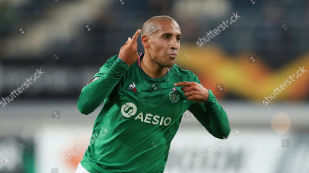 Stock Image of Saint Etienne's Wahbi Khazri celebrates after scoring his side's first goal during the Europa League group I soccer match between Gent and Saint Etienne at KAA Gent Stadium in Ghent, Belgium