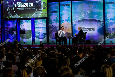 Stock Picture of Democratic presidential candidate and South Bend Mayor Pete Buttigieg, accompanied by Ali Velshi, speaks during the Climate Forum at Georgetown University, in Washington