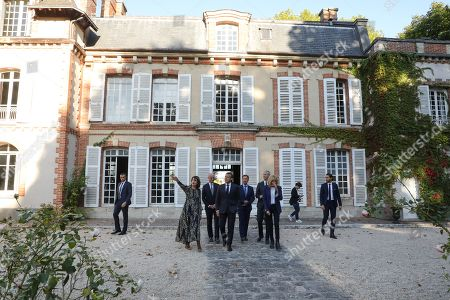 (L-R) Katherine Brault, who for the last two years has owned the Chateau de By ('By Castle') - the former property of the late French artist Rosa Bonheur, French Education and Youth Affairs Minister Jean-Michel Blanquer, French TV host Macron's cultural special adviser and Stephane Bern (partially hidden), French President Emmanuel Macron, French Culture Minister Franck Riester and Macron's wife Brigitte Macron visit the Chateau de By in Thomery, outside Paris, France, 20 September 2019. In support of the European Heritage Days, Emmanuel and Brigitte Macron visited the residence of the painter Rosa Bonheur on September 20, one of the emblematic projects that receive financial support from the heritage mission. The French Ministry of Culture has selected 18 emblematic sites to profit from the 'Loto du patrimoine' draw.
