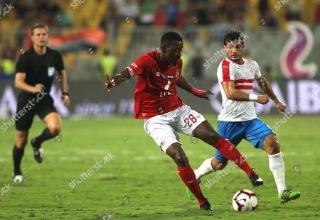 Al-Ahly player Jonior Ajaieh (L) in action against Zamalek player Tarek Hamed during the Egyptian Super cup soccer match between Zamalek and Al-Ahly at Borg Al-Arab Stadium in Alexandria, Egypt, 20 September 2019.