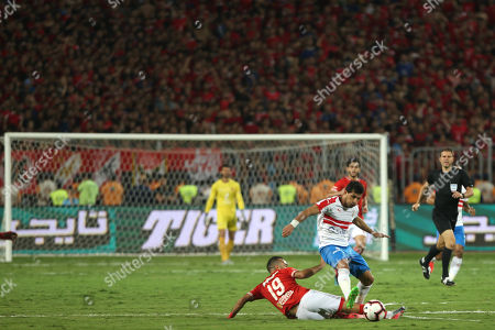 Al-Ahly player  Magdy Afsha (L) in action against Zamalek player Tarek Hamed during the Egyptian Super cup soccer match between Zamalek and Al-Ahly at Borg Al-Arab Stadium in Alexandria, Egypt, 20 September 2019.