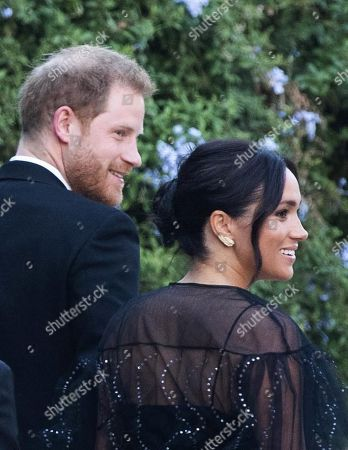 Britain's Prince Harry, Duke of Sussex (L) and his wife, Meghan, Meghan Duchess of Sussex (R) arrive for the wedding ceremony of fashion designer Misha Nonoo and businessman Michael Hess at Villa Aurelia in Rome, Italy, 20 September 2019.